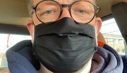 Fahrer mit Atemschutzmaske, Corona