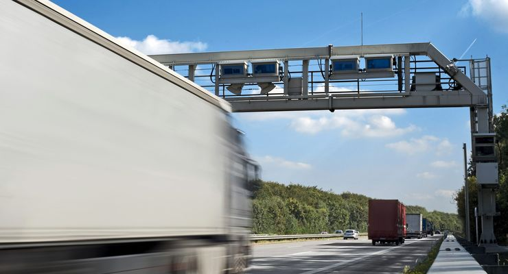 Truck toll system, german highway - control gantry, motion blur on truck